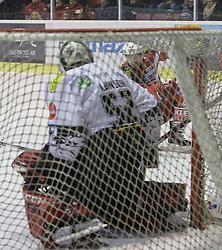 14.12.2014, Stadthalle, Klagenfurt, AUT, EBEL, EC KAC vs Dornbirner Eishockey Club, 27. Runde, im Bild Jason Desantis (EC KAC, #5), Nathan Lawson (Dornbirner Eishockey Club, #52) // during the Erste Bank Icehockey League 27th round match betweeen EC KAC and Dornbirner Eishockey Club at the City Hall in Klagenfurt, Austria on 2014/12/14. EXPA Pictures © 2014, PhotoCredit: EXPA/ Gert Steinthaler