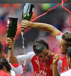 Arsenal's Aaron Ramsey pours champagne over Arsenal's Mathieu Flamini - Photo mandatory by-line: Joe Meredith/JMP - Mobile: 07966 386802 10/08/2014 - SPORT - FOOTBALL - London - Wembley Stadium - Arsenal v Manchester City - FA Community Shield