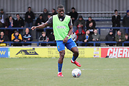 AFC Wimbledon defender Deji Oshilaja (4) warming up during the EFL Sky Bet League 1 match between AFC Wimbledon and Oxford United at the Cherry Red Records Stadium, Kingston, England on 10 March 2018. Picture by Matthew Redman.