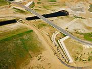 Nederland, Limburg, Gemeente Horst aan de Maas.; 27-05-2020; Ooijen, nieuwe brug over de (uitgegraven) Oude Maasarm tussen Ooijen en Wanssum (nabij het recreatiepark Kasteel Ooijen). Bij hoogwater kan de de oude rivier weer mee gaan stromen. Onderdeel van <br /> Gebiedsontwikkeling  Ooijen en Wanssum, waaronder aanleg van een  hoogwatergeul, weerdverlaging en natuurontwikkeling.<br /> Ooijen, new bridge over the (excavated) old branch of the Meuse. Near the recreation park Kasteel Ooijen. At high tide, the old river can flow again.<br /> <br /> luchtfoto (toeslag op standard tarieven);<br /> aerial photo (additional fee required)<br /> copyright © 2020 foto/photo Siebe Swart