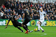 Swansea city's Jonjo Shelvey ® looks to break through the Man city defence. Barclays Premier league, Swansea city v Manchester City at the Liberty Stadium in Swansea,  South Wales on  New years day Wed 1st Jan 2014 <br /> pic by Andrew Orchard, Andrew Orchard sports photography.