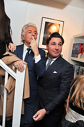 Left to right, GIANCARLO GIAMMETTI and GIORGIO VERONI at a private view of photographs by Anthony Souza held at The Little Black Gallery, 13A Park Walk, London SW10 on 13th December 2011.