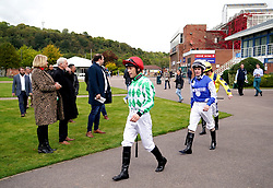 Jockey Ben Curtis (left) makes his way out ahead of the British EBF Maiden Fillies' Stakes at Nottingham Racecourse. Picture date: Wednesday October 13, 2021.