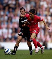 Photo: Jed Wee, Digitalsport<br /> Liverpool v Sunderland. The Barclays Premiership.<br /> 20/08/2005.<br /> Liverpool's Luis Garcia (R) holds off Sunderland's Julio Arca<br /> Norway only