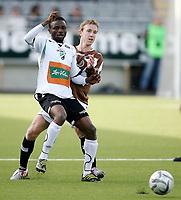 Fotball <br /> Adeccoligaen<br /> AKA Arena , Hønefoss <br /> 21.05.09<br /> Hønefoss BK  v Mjøndalen  0-0<br /> <br /> Foto: Dagfinn Limoseth, Digitalsport<br /> Kevin Nicol , Mjøndalen og Umaru Banguru , Hønefoss