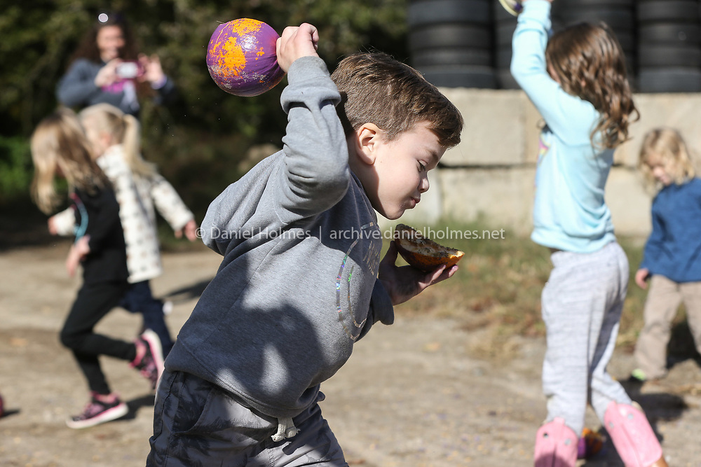 (10/6/19, MENDON, MA) Christopher Hohn, 6, smashes a  pumpkin to raise awareness about MPS at Cedar Hill Farm in Mendon on Sunday. Hohn suffers from Mucopolysaccharidosis (MPS) is a disease where the body is missing enough of an enzyme needed to break down sugar molecules. [Daily News and Wicked Local Photo/Dan Holmes]
