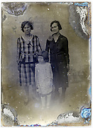 two adult woman and young girl posing on severely eroded glass plate
