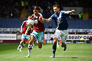 George Boyd of Burnley and Jonathan Grounds of Birmingham City (r) chase the ball . Skybet football league championship match, Burnley  v Birmingham City at Turf Moor in Burnley, Lancs on Saturday 15th August 2015.<br /> pic by Chris Stading, Andrew Orchard sports photography.