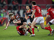 Matthew Screech of the Newport Gwent Dragons is tackled to the ground .<br /> Guinness Pro12 rugby match, Munster v Newport Gwent Dragons at Thomond Park in Limerick , Ireland on Saturday 5th March 2016.<br /> pic by  John Halas, Andrew Orchard sports photography.