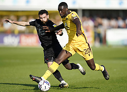 Port Vale's David Worrall (left) and Sutton United's Enzio Boldewijn battle for the ball during the Sky Bet League Two match at Borough Sports Ground, Sutton. Picture date: Saturday October 9, 2021.