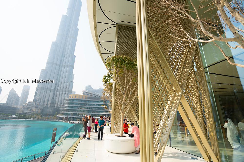 Balcony of Apple Store in Dubai Mall overlooking pond and Burj Khalifa in Dubai, UAE, United Arab Emirates