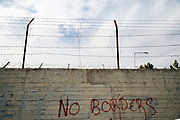 Greece. Lesvos. Moria  camp for refugees in transit from Turkey to Greece. Graffiti saying 'No borders'. The camp was formerly a detention centre.