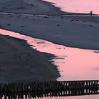 The colors of a brilliant sunset are reflected in the waters of Aptos Creek as it winds through Rio Del Mar Beach towards the Monterey Bay.<br /> Photo by Shmuel Thaler <br /> shmuel_thaler@yahoo.com www.shmuelthaler.com
