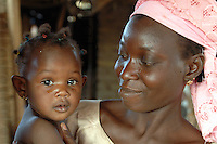 Burkina Faso, Dori, 2007. A mother looks proudly at her daughter as she learns to accept a stranger.