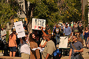 """About 1,000 demonstrators participated in Occupy Tucson at Military Plaza in Armory Park, Tucson, Arizona, USA.  The Occupy Tucson organizers created the movement in solidarity with the Occupy Wall Street movement in New York and the Occupy Together movement across the USA.  A counter protestor (brown shirt), who declined to be identified, shouts, """"Stop protesting and get a fuckin job."""" ..The leaders of this movement are the everyday people participating in a movement with many de-centralized goals, with an over-arching theme of protesting government corruption from corporate money and national income disparity. We use a tool called the """"General Assembly"""" to facilitate open, participatory and horizontal organizing between members of the public. We welcome people from all colors, genders and beliefs to participate in our movement. .."""