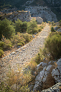 Old stone road on Route Napoleon in mountains, Seranon, France