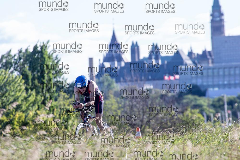 (Ottawa, Canada---10 August 2013)  David Burkhart (605)  of United States (USA) competing in the 55-59 Male AG International Triathlon Union 2013 World Duathlon Championships (10 km run- 40 km bike- 5km run).