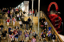 © Licensed to London News Pictures.04/08/2012 LONDON UK.Day 8 London 2012 Olympic Games. .Athletics fans make their way home on the Greenway,  after watching Mo Farrah, Jessica Ennis and Greg Rutherford win gold in the Olympic Stadium on what has been Great Britain's most successful day for Olympic Gold with a total of six gold medals being won. Photo credit : Andrew Baker/LNP