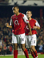 2/11/2004<br />UEFA Champion's League - Arsenal v  Panathiniakos - HIghbury<br />Arsenal's Thierry Henry calmly celebrates with Freddie Ljungberg after scoring opening goal from a penalty<br />Photo:Jed Leicester/BPI (back page images)