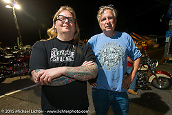 Andy George and event organizer Charlie St. Clair in the Weir's at night during Laconia Motorcycle Week. Laconia, NH, USA. June 13, 2015.  Photography ©2015 Michael Lichter.