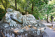 La Nuda Abbandonate, the abandoned nude sleeping nymph statue, commissioned by Piaer Francesco Orsini c. 1513-84, The Renaissance Mannerist statues of the Park of Monsters or The Sacred Wood of Bamarzo, Italy .<br /> <br /> Visit our ITALY HISTORIC PLACES PHOTO COLLECTION for more   photos of Italy to download or buy as prints https://funkystock.photoshelter.com/gallery-collection/2b-Pictures-Images-of-Italy-Photos-of-Italian-Historic-Landmark-Sites/C0000qxA2zGFjd_k .<br /> <br /> Visit our EARLY MODERN ERA HISTORICAL PLACES PHOTO COLLECTIONS for more photos to buy as wall art prints https://funkystock.photoshelter.com/gallery-collection/Modern-Era-Historic-Places-Art-Artefact-Antiquities-Picture-Images-of/C00002pOjgcLacqI
