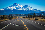 Mount Shasta is located at the southern end of the Cascade Range in Siskiyou County, California and at 14,179 feet is the second highest peak in the Cascades and the fifth highest in California. Mount Shasta has an estimated volume of 85 cubic miles which makes it the most voluminous stratovolcano in the Cascade Volcanic Arc.<br /> <br /> The mountain and its surrounding area are managed by the U.S. Forest Service, Shasta-Trinity National Forest.<br /> <br /> Mount Shasta is not connected to any nearby mountain and dominates the northern California landscape. It rises abruptly and stands nearly 10,000 ft above the surrounding terrain. On a clear winter day snowy Mount Shasta can be seen from the floor of the valley 140 miles south. The mountain has attracted the attention of poets, authors, and presidents.<br /> The mountain consists of four overlapping volcanic cones which have built a complex shape, including the main summit and the prominent satellite cone of 12,330 ft Shastina, which has a visibly conical form. If Shastina were a separate mountain, it would rank as the fourth-highest peak of the Cascade Range (after Mt. Rainier, Rainier's Liberty Cap, and Mt. Shasta itself).<br /> <br /> Mount Shasta's surface is relatively free of deep glacial erosion except, paradoxically, for its south side where Sargents Ridge runs parallel to the U-shaped Avalanche Gulch. This is the largest glacial valley on the volcano, although it does not presently have a glacier in it. There are seven named glaciers on Mount Shasta, with the four largest (Whitney, Bolam, Hotlum, and Wintun) radiating down from high on the main summit cone to below 10,000 ft primarily on the north and east sides. The Whitney Glacier is the longest and the Hotlum is the most voluminous glacier in the state of California. Three of the smaller named glaciers occupy cirques near and above 11,000 ft on the south and southeast sides, including the Watkins, Konwakiton, and Mud Creek Glaciers.