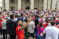 Licensed to London News Pictures. 11/07/2021. London, UK. Fans go wild as they gather at St Martin-in-the-Fields Church at Trafalgar Square in London ahead of England's Euro 2020 finals match. England take on Italy in the Euro 2020 final at the iconic Wembley Stadium this evening. Photo credit: Alex Lentati/LNP