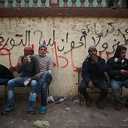 Egyptian protestors take a break after a long day of constant clashes with the security forces in central Cairo.