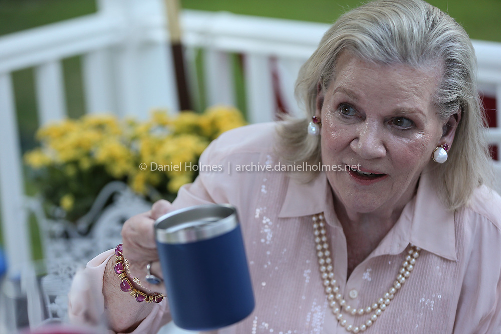 (7/25/20, WELLESLEY, MA) Ellen Walsh raises a glass  during the ALS fundraiser at the Walsh home in Wellesley on Saturday. [Daily News and Wicked Local Photo/Dan Holmes]