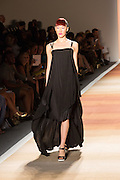 A black dress with thin leather spaghetti straps, a dip hem and asymmetrical layers.
