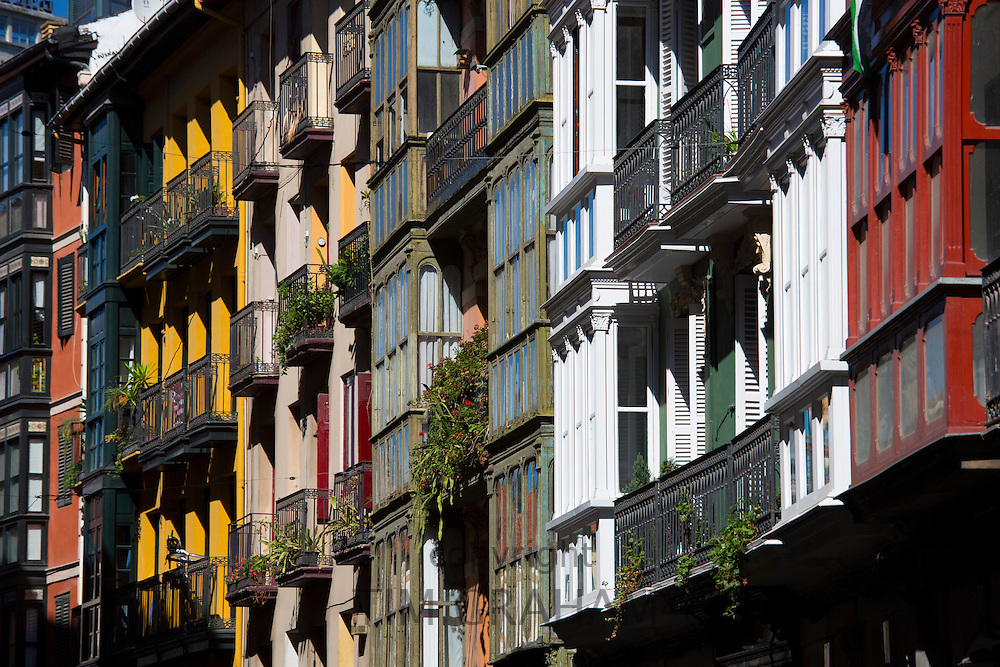 Traditional glasshouses with glass-covered balconies in Bilbao, Spain RESERVED USE