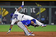 Kansas City Royals right fielder Jorge Bonifacio (38) gets tagged out at second base by Toronto Blue Jays second baseman Devon Travis (29), attempting to stretch a single into a double during the second inning against the Toronto Blue Jays at Kauffman Stadium.