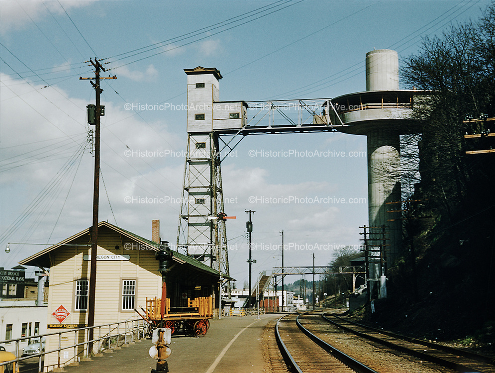 CS00331-06. The original Oregon City Elevator, built in 1915, and the new one to replace it, at the time of construction in 1955