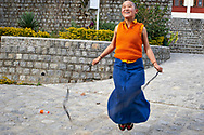 Just before the classes begin, the nunnery echoes with children's games, even though the young nuns often recite texts in Tibetan language until late in the night in order to memorize them - Shugsep nunnery, Dharamsala, India, 2012