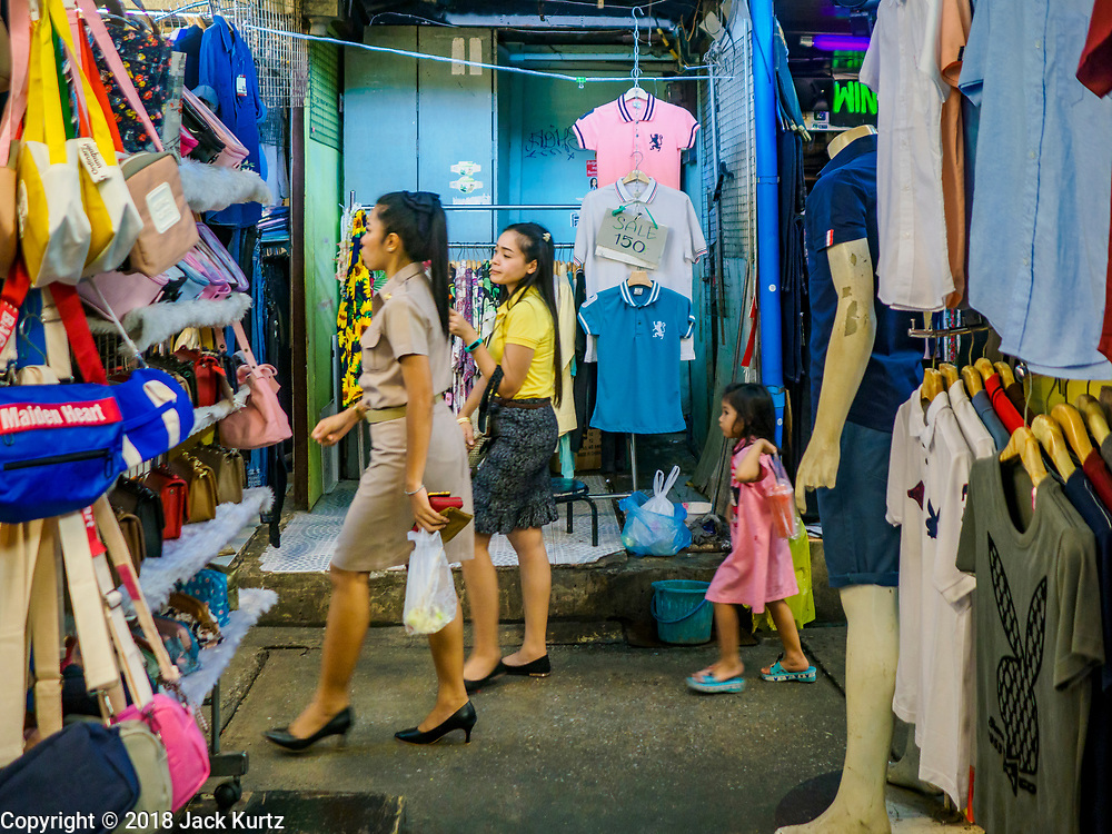 17 SEPTEMBER 2018 - BANGKOK, THAILAND:  Shoppers in Klong San market, next to the ICONSIAM development. ICONSIAM is a mixed-use development on the Thonburi side of the Chao Phraya River. It is expected to open in 2018 and will include two large malls, with more than 520,000 square meters of retail space, an amusement park, two residential towers and a riverside park. It is the first large scale high end development on the Thonburi side of the river and will feature the first Apple Store in Thailand and the first Takashimaya department store in Thailand. Rents for shopkeepers in Klong San market are up to 30,000 Thai Baht per month (about $920US) and some in Bangkok are concerned that Klong San Market will lose its local character when the huge mall opens.   PHOTO BY JACK KURTZ