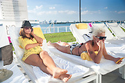 DAWN MAGNOTTO; LORI CHEEK, Mondrian Hotel by the pool.  Miami Beach. 2 December 2010. -DO NOT ARCHIVE-© Copyright Photograph by Dafydd Jones. 248 Clapham Rd. London SW9 0PZ. Tel 0207 820 0771. www.dafjones.com.