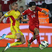 Turkey's Arda Turan (R) and Romania's Gabriel Sebastian Tamas during their FIFA World Cup 2014 qualifying soccer match Turkey betwen Romania at Sukru Saracoglu stadium in Istanbul october 12, 2012. Photo by TURKPIX