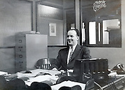 office employee behind his desk America 1940s
