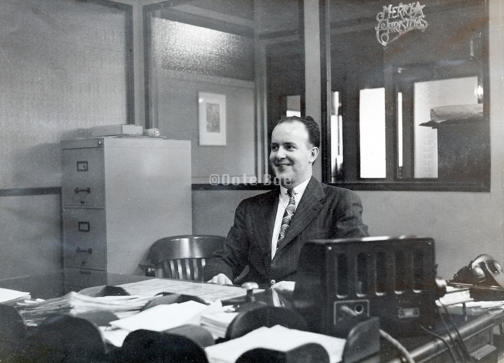 office employee behind his desk America 1940s