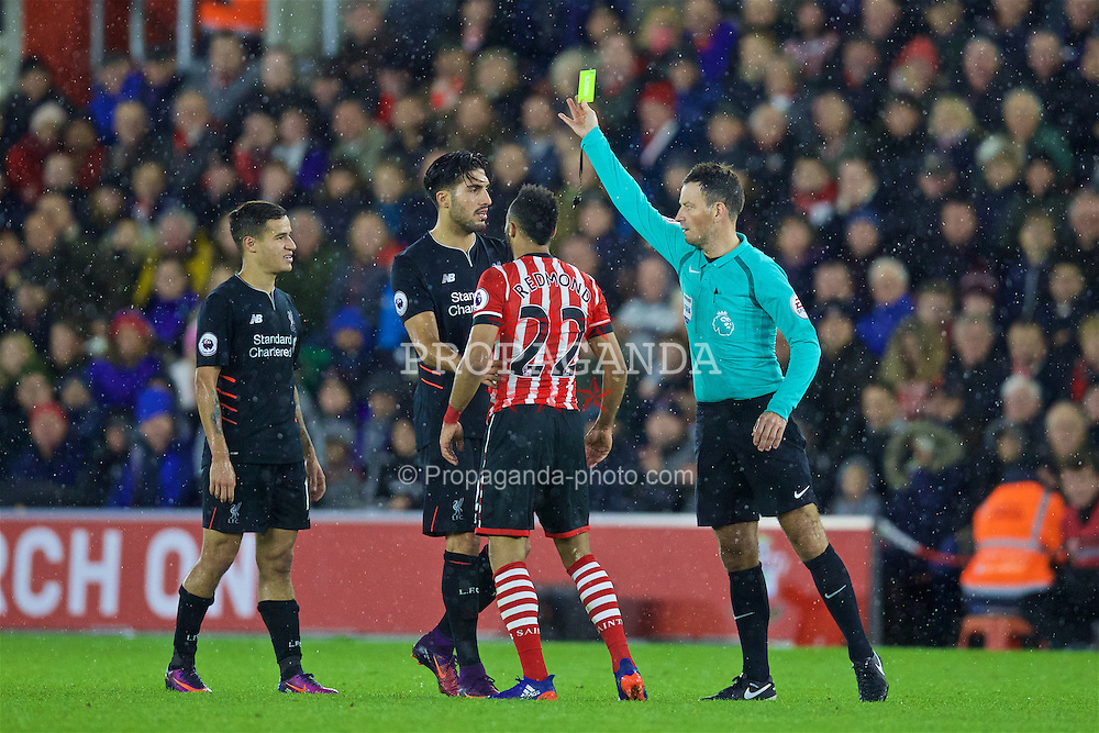SOUTHAMPTON, ENGLAND - Saturday, November 19, 2016: Liverpool's Philippe Coutinho Correia [L] is shown a yellow card by referee Mark Clattenburg during the FA Premier League match against Southampton at St. Mary's Stadium. (Pic by David Rawcliffe/Propaganda)