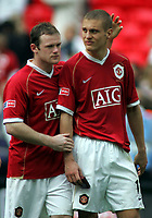 Photo: Paul Thomas.<br /> Chelsea v Manchester United. The FA Cup Final. 19/05/2007.<br /> <br /> Dejected Wayne Rooney and Nemanja Vidic (R) of Utd.
