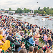 Eights race and the crowd <br /> <br /> Racing at the Henley Royal Regatta on The Thames river, Henley on Thames, England. Saturday 6 July 2019. © Copyright photo Steve McArthur / www.photosport.nz