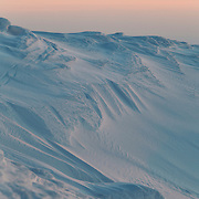 Puy de Chabane detail covered with snow and sunset ligt