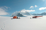 Alaska. Matanuska Valley Susitna Borough. Knik Glacier in the Chugach Mountains with Helicopter. Helicopter ecotourism in Alaska.