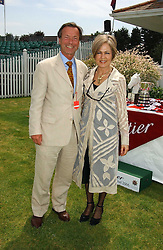 GILLIAN DEL BONO and KLAUS SCHRIENER at the Queen's Cup polo final sponsored by Cartier at Guards Polo Club, Smith's Lawn, Windsor Great Park on 18th June 2006.  The Final was between Dubai and the Broncos polo teams with Dubai winning.<br /><br />NON EXCLUSIVE - WORLD RIGHTS