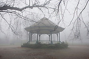 London park bandstand on an early misty morning.