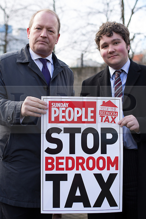 © Licensed to London News Pictures . 16/03/2013 . Manchester , UK . L-R Simon Danczuk , Labour MP for Rochdale and Liam O'Rourke , Labour Councillor for North Heywood , holding a STOP BEDROOM TAX poster . Hundreds of protesters opposed to changes to housing benefit , known as the Bedroom Tax , in Piccadilly Gardens in Manchester City Centre today (16th March) as part of a coordinated campaign of demonstrations in cities across the UK . The government plans to introduce changes to housing benefit from this April which will see some claimants receive a reduced amount if they have excess living space . Photo credit : Joel Goodman/LNP