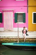 Tourist having their photograph taken, Island of Burano, Venice, Italy, Europe