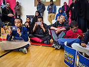 16 MARCH 2019 - BLOOMINGTON, MINNESOTA, USA: Somali-American children use their phones to record speakers at Dar al Farooq Center in Bloomington. An interdenominational crowd of about 1,000 people came to the center to protest white supremacy and religious intolerance and to support Muslims in New Zealand who were massacred by a white supremacist Friday. The Twin Cities has a large Muslim community following decades of Somali immigration to Minnesota. There are about 45,000 people of Somali descent in the Twin Cities.   PHOTO BY JACK KURTZ