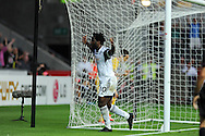 Swansea city's Wilfried Bony celebrates after he scores his sides 4th goal.  UEFA Europa league, play off round, 1st leg match, Swansea city v FC Petrolul Ploiesti at the Liberty stadium in Swansea on Thursday 22nd August 2013. pic by Andrew Orchard , Andrew Orchard sports photography,